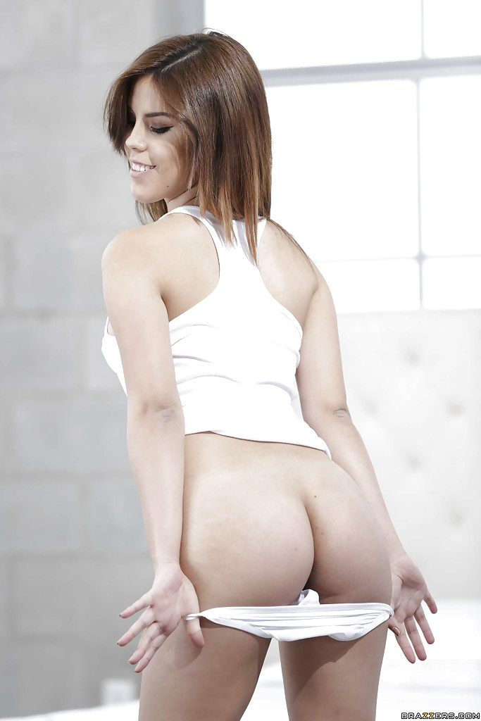 Solo girl Lilith Shayton flaunts nice ass before masturbating shaved pussy