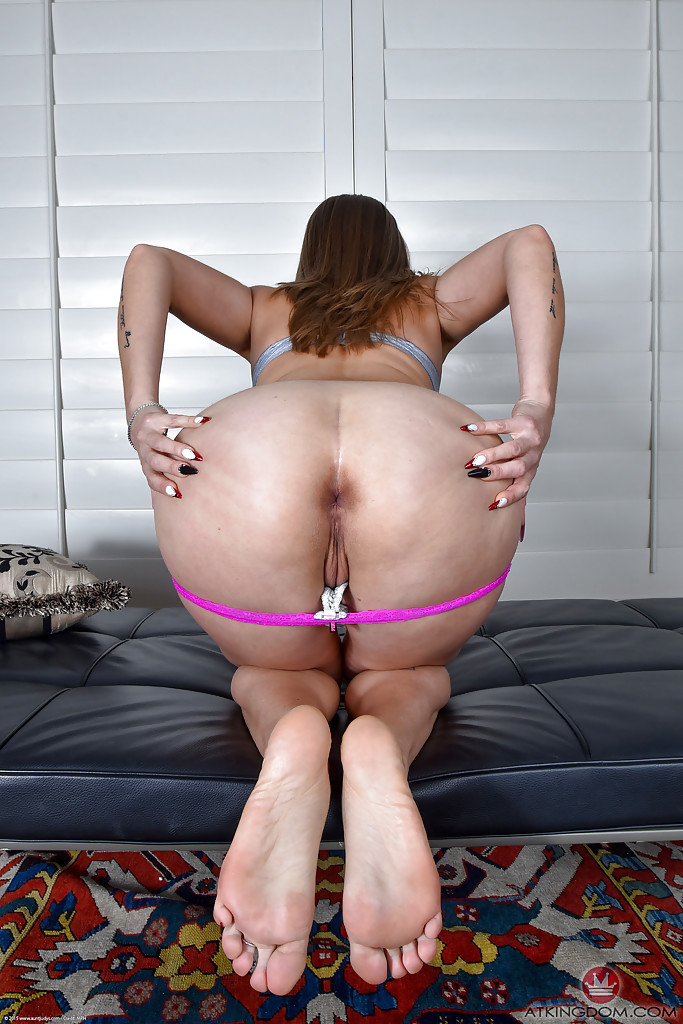 Older MILF Miss MelRose slides panties aside to part labia lips