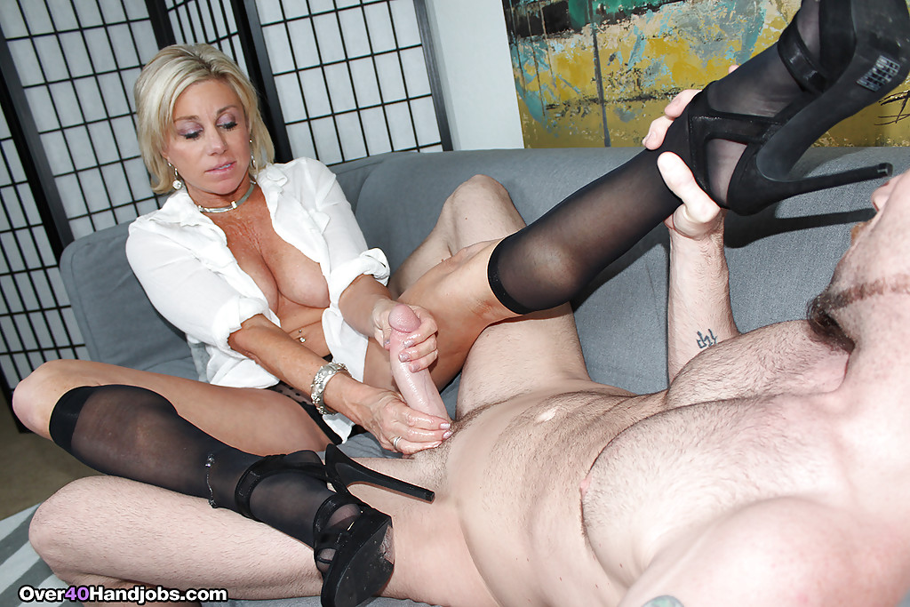 ... Over 40 blonde MILF in nylon socks and high heels jerking cock ...