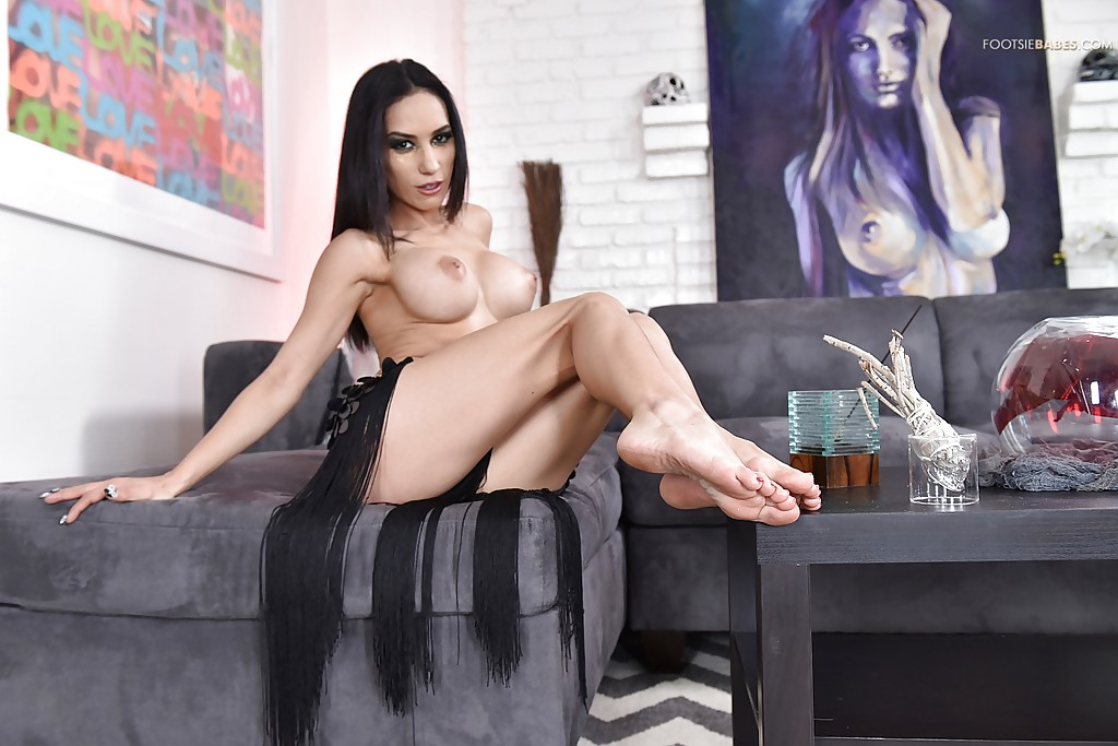 Latina babe Tia Cyrus unveiling large tits before spreading trimmed pussy
