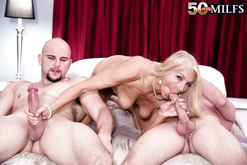image Two blondes bent over backwards for work