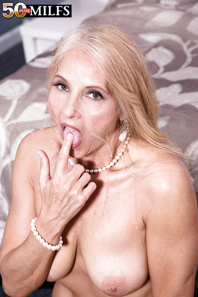 Floppy tit mature takes a big facial