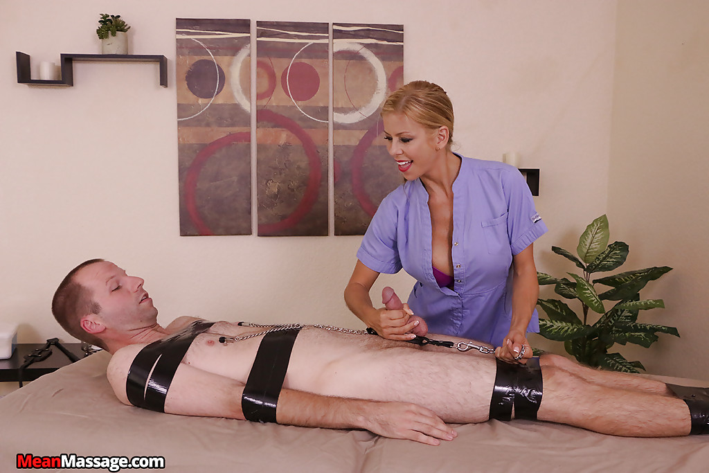 Busty blonde massagist face sitting bound man while giving femdom handjob