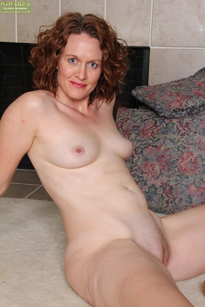 image Busty old spunker strips and shows off her sexy body