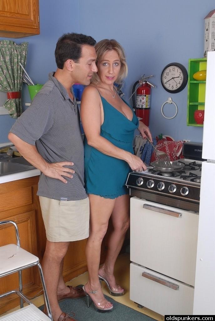 Mature sex in kitchen