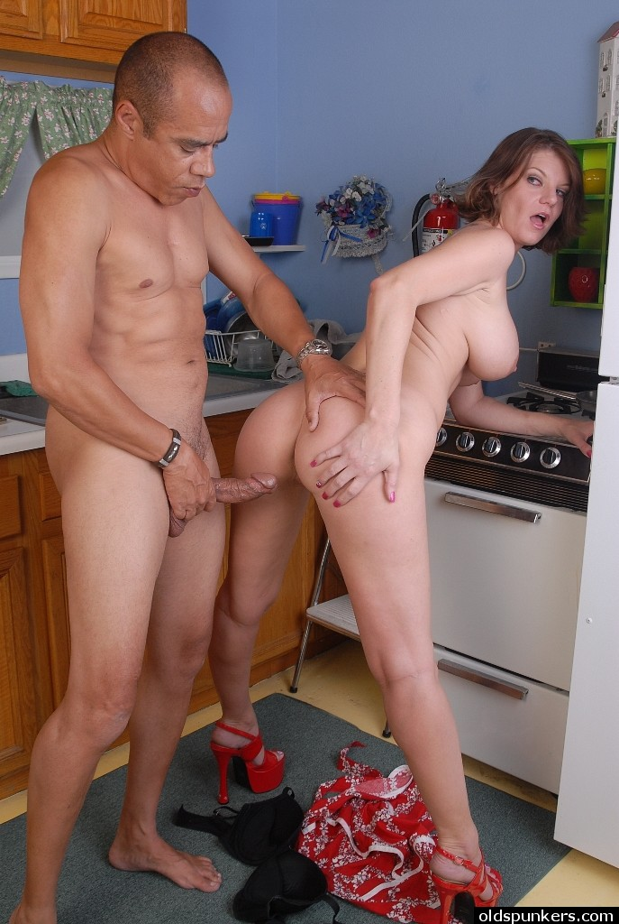 Busty interracial kitchen
