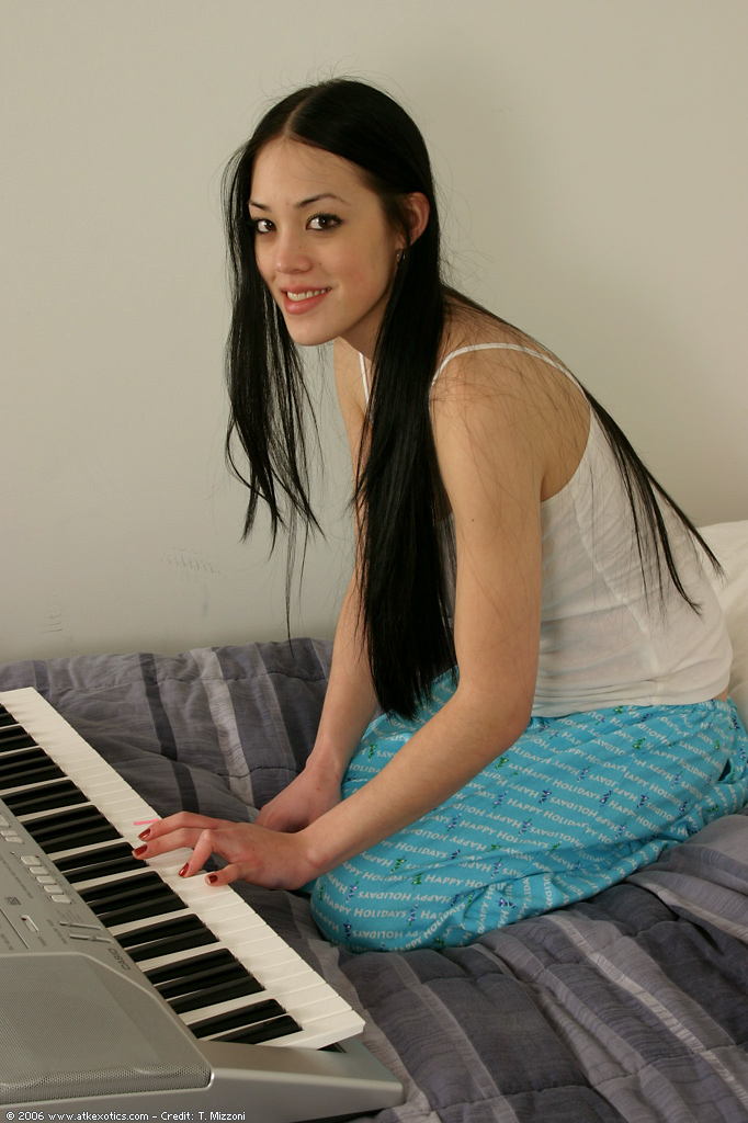 Naked girl playing keyboard