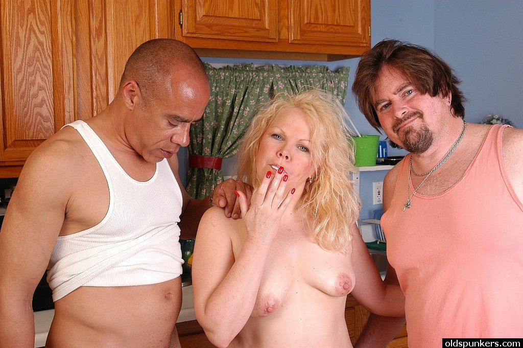 ... Mature blonde with fat ass enjoying interracial sex in MMF threesome ...