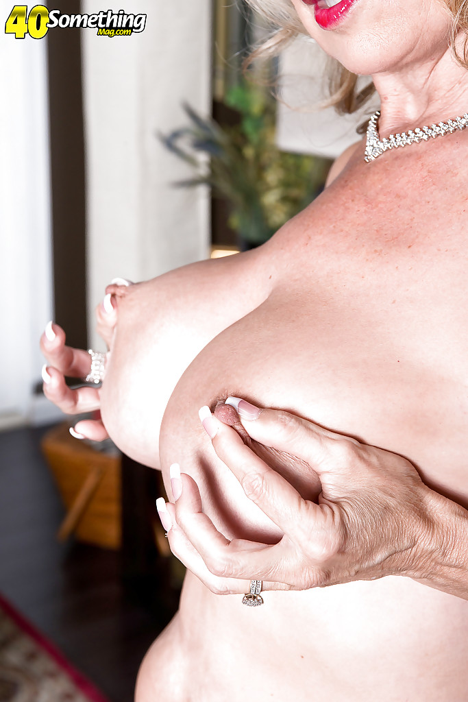 Over 40 MILF pornstar Laura Layne freeing large boobs and shaved snatch