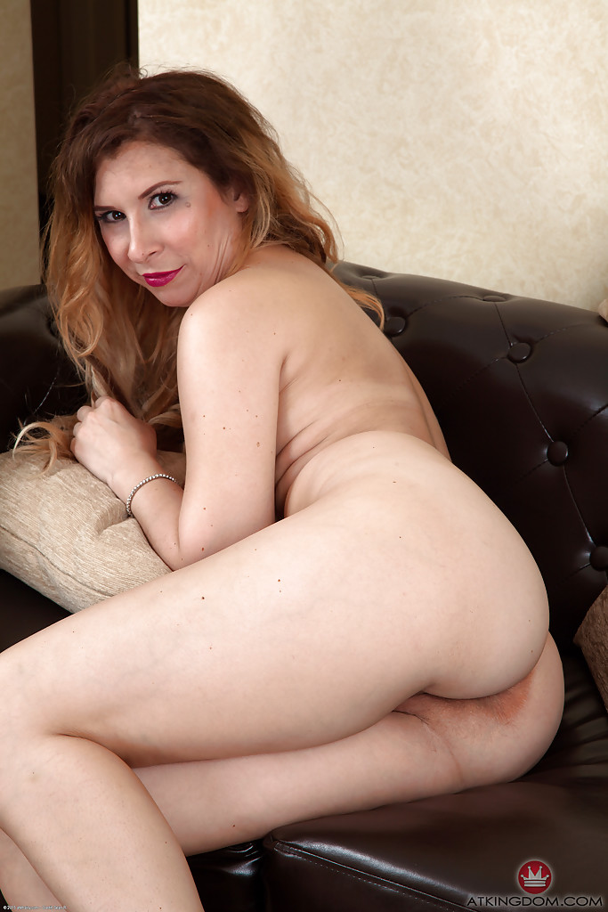 Clothed older woman undresses to expose hairy vagina and buttocks