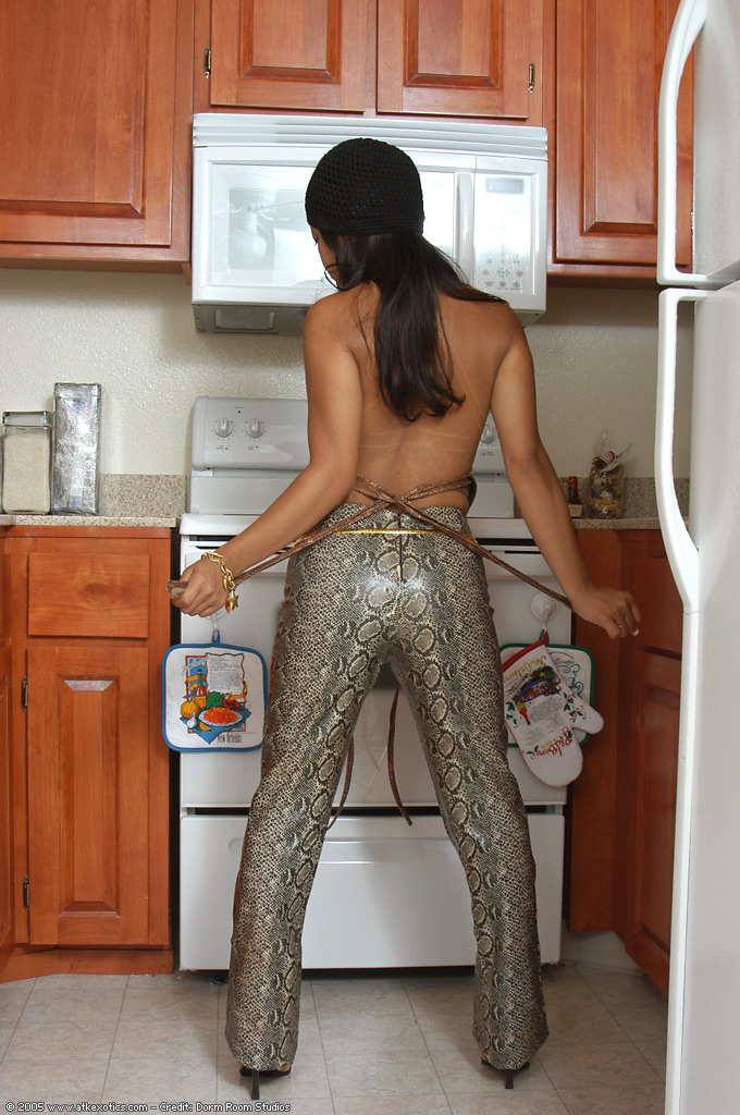 Amateur Latina stripping naked but for boots and hat in kitchen