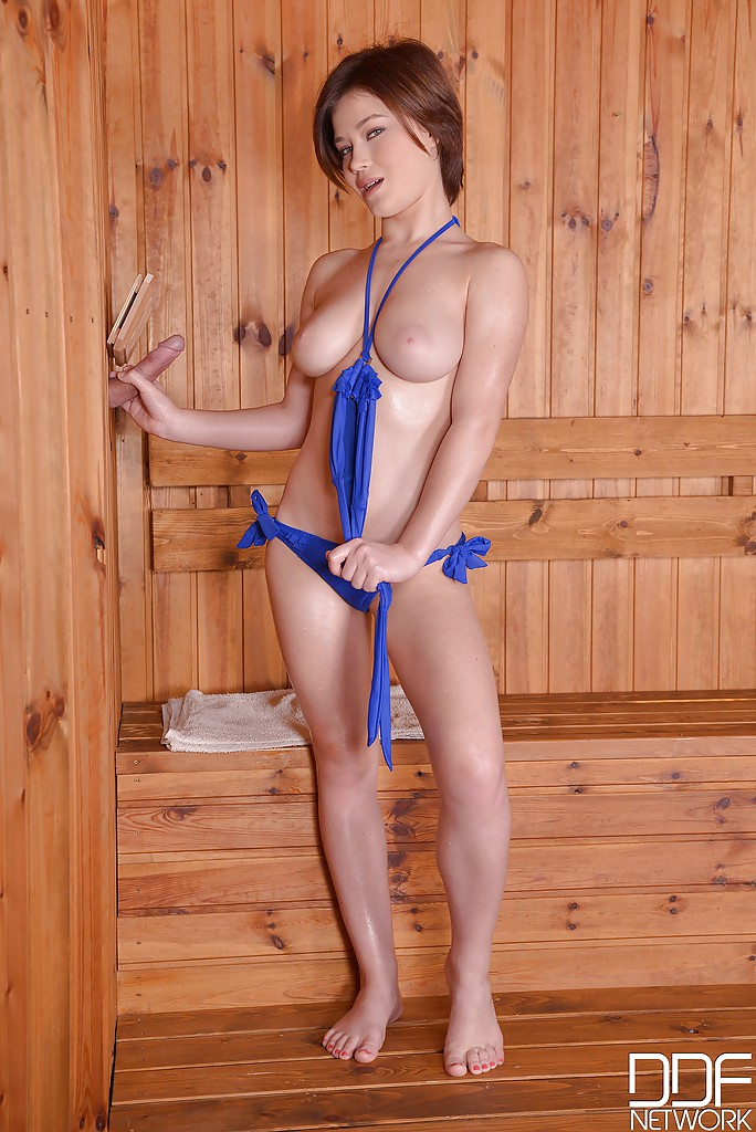 Busty bikini clad Veronica Morre giving blowjob at sauna ...