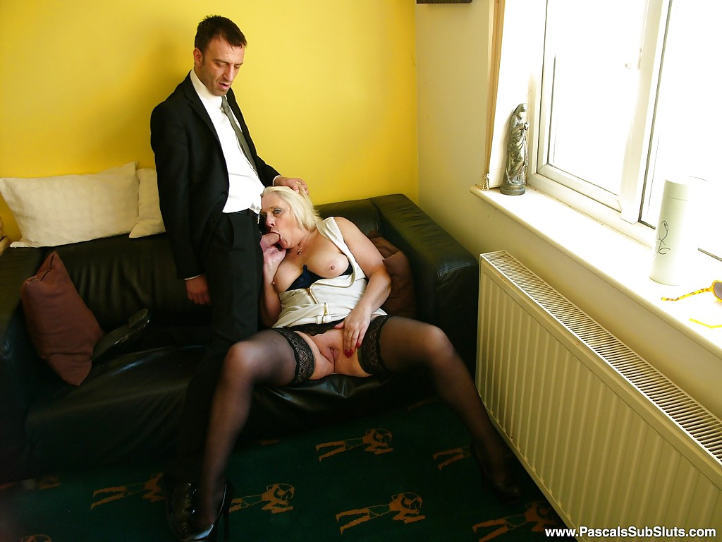 mature european amateur in stockings deepthroating cock during