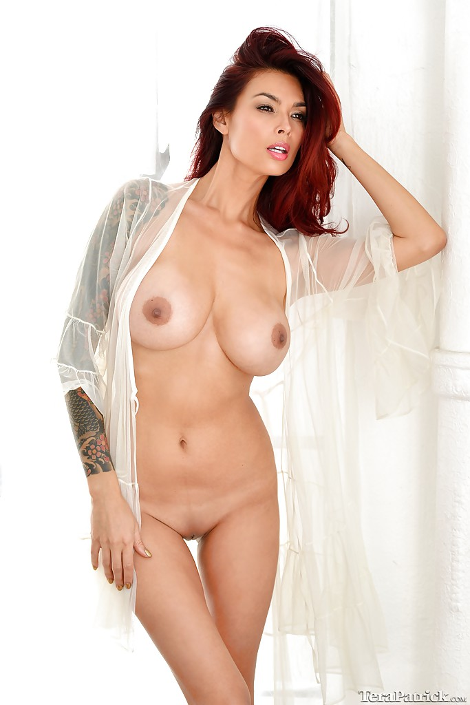 hot redhead pornstar tera patrick touting huge asian tits
