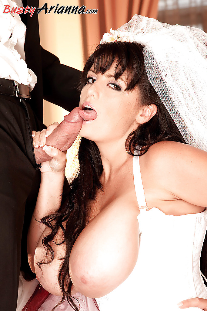 Big boobed bride Arianna Sinn giving a blowjob in her