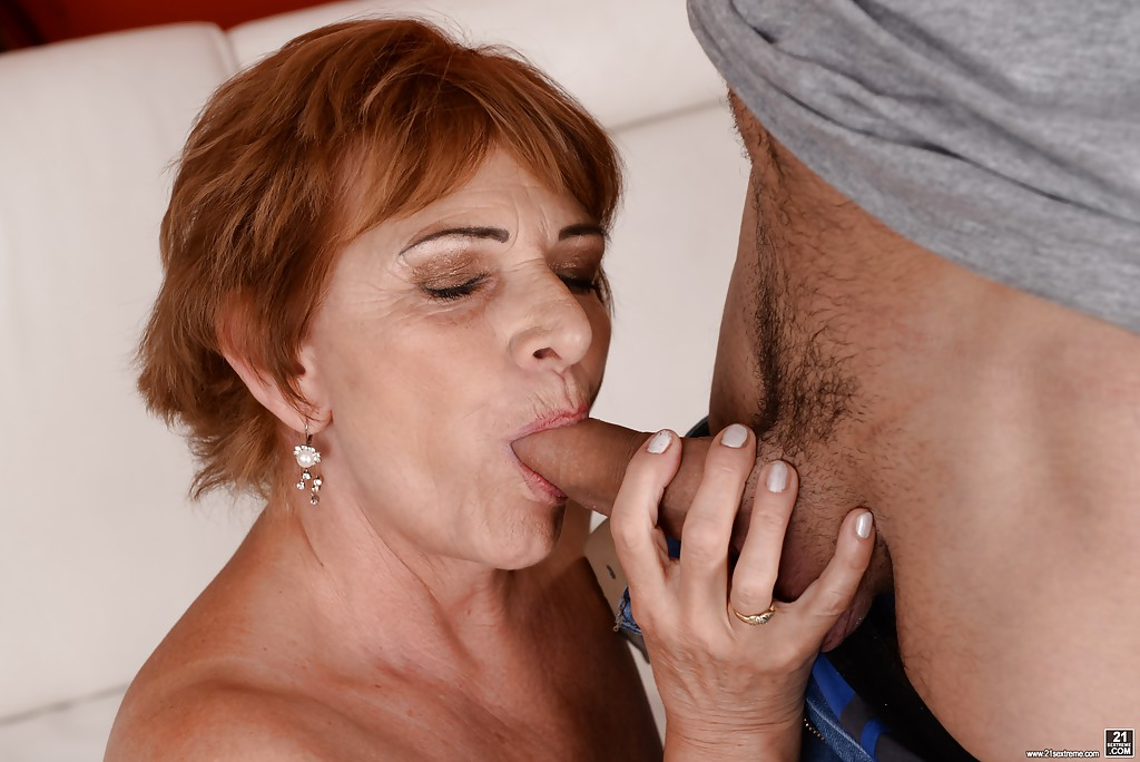 redhead gran sally g giving younger man oral sex and