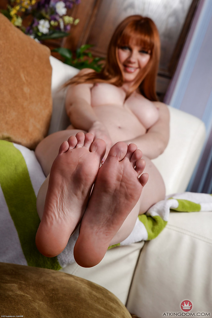 Curious Redhead with bare feet