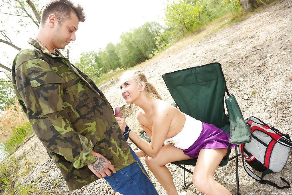 Blonde teen Cayla A giving fisherman oral sex by water