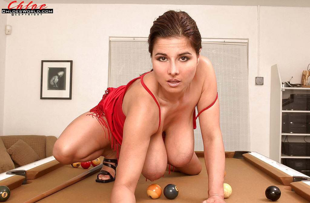 European MILF Chloe Vevrier revealing amazing knockers on pool table