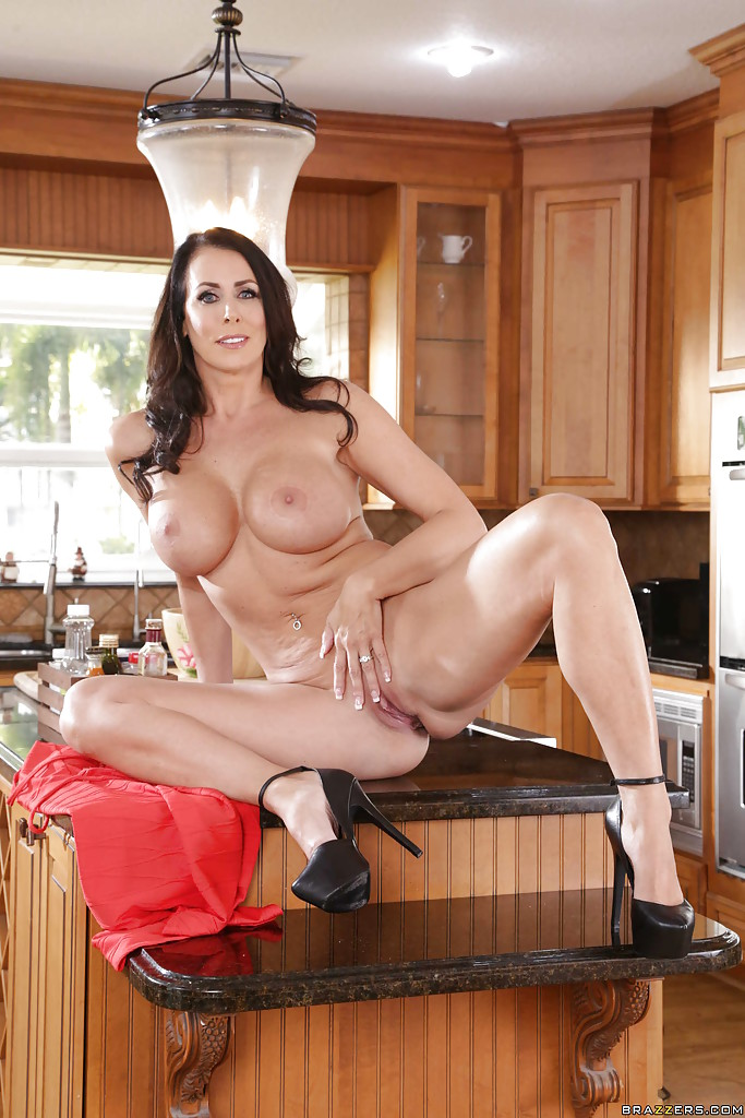 Older wife Reagan Foxx letting round boobs loose on kitchen countertop