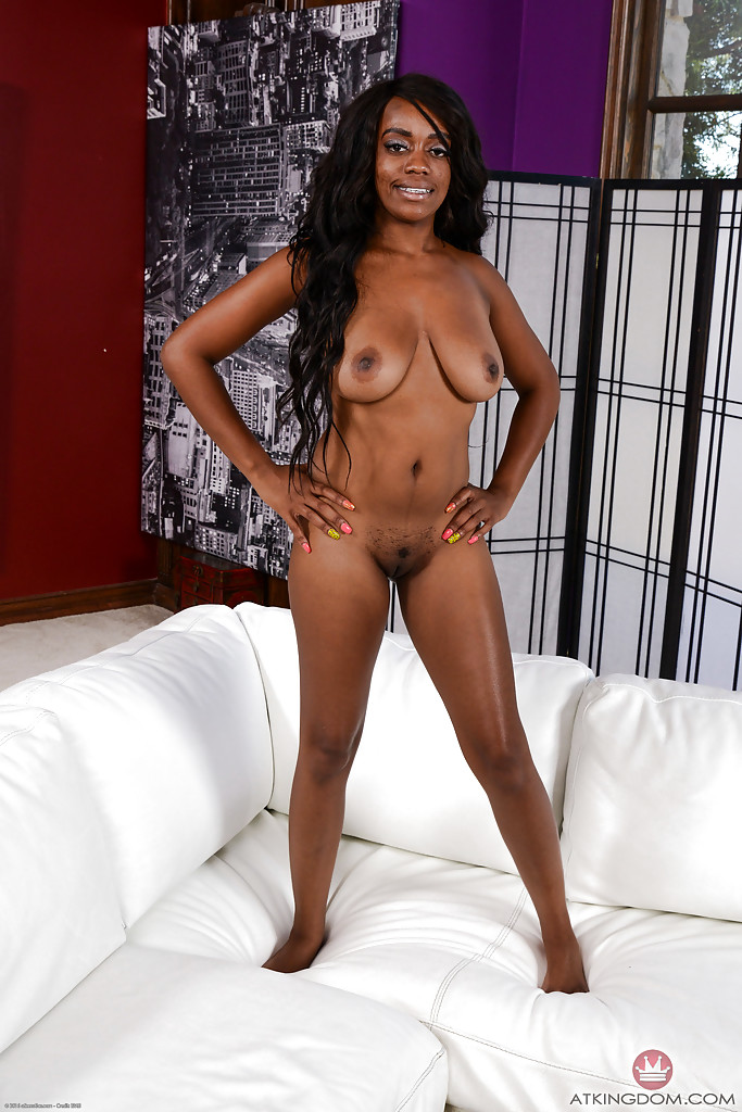 Luscious ebony babe Amber Cream exposes her mind-blowing bald pussy and boobs
