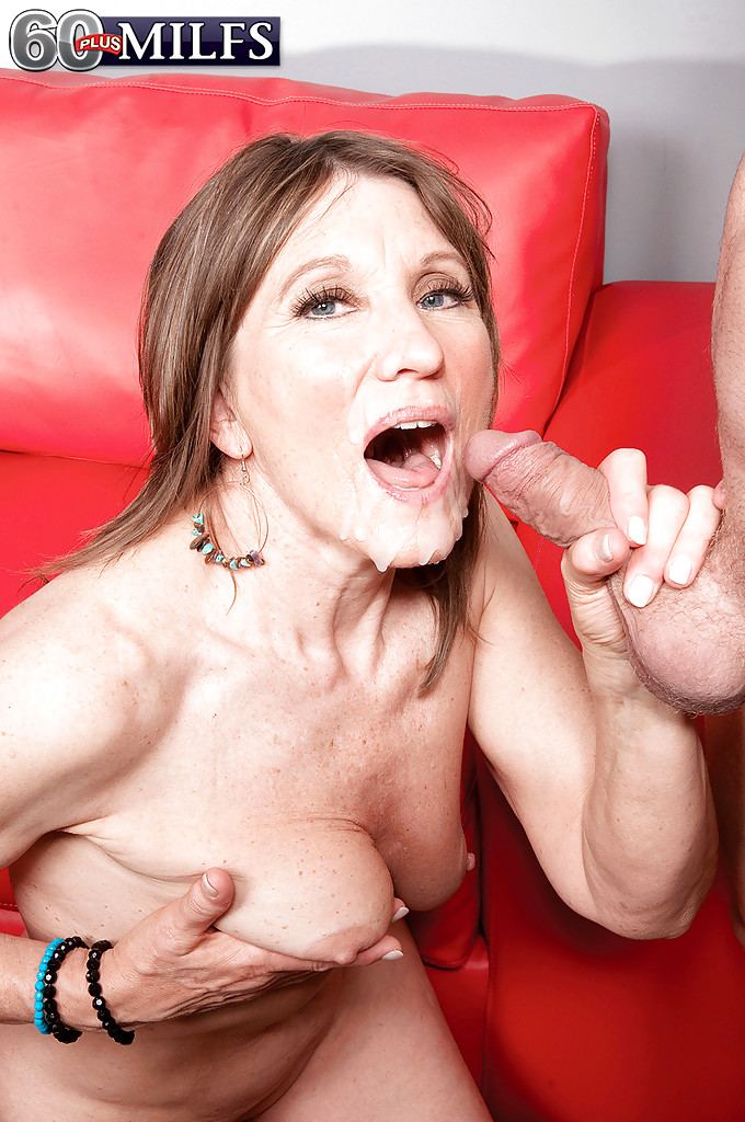 Mature beauty Donna Davidson plays with young cock in ...