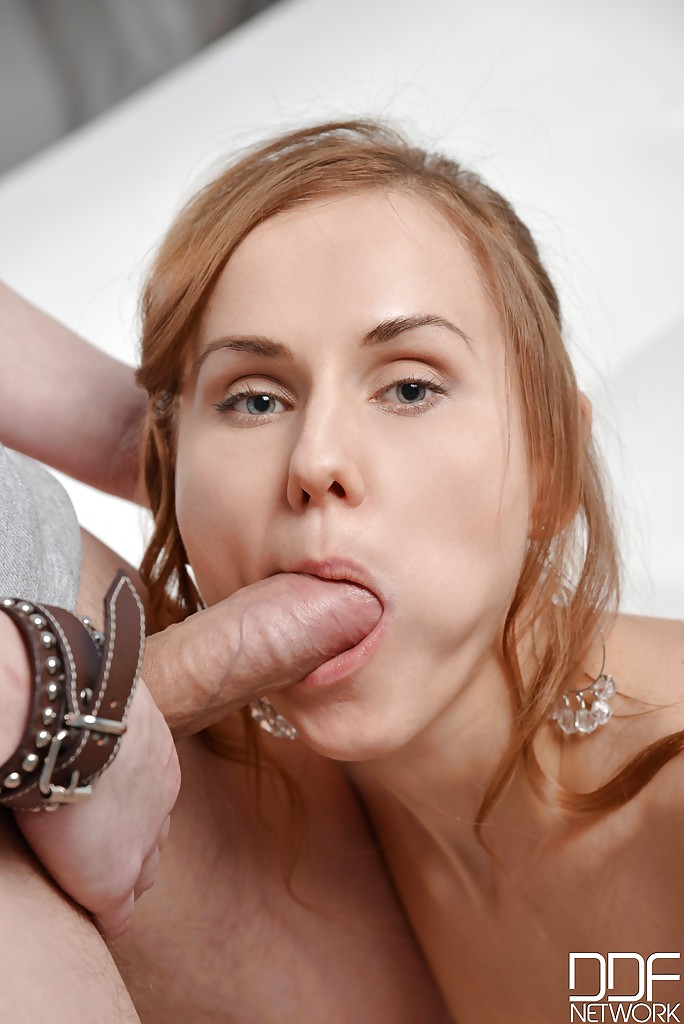 Natural redhead Sabrina Moor masturbating her pussy while giving blowjob