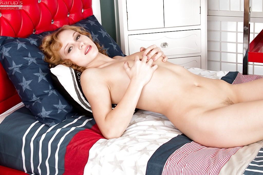 Teen first timer Alice Urban folding back labia lips after undressing on bed