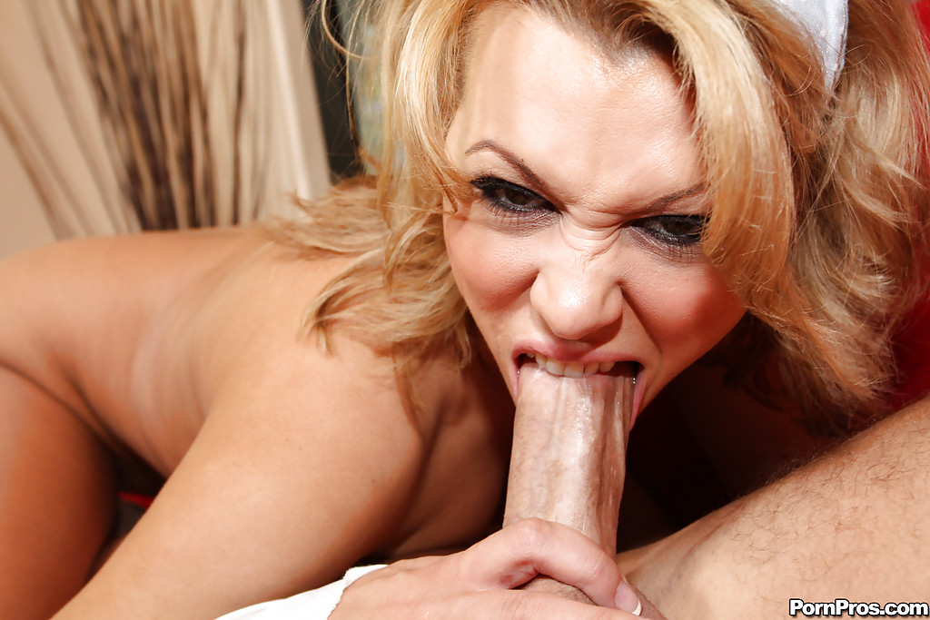 Blonde milf biting cock