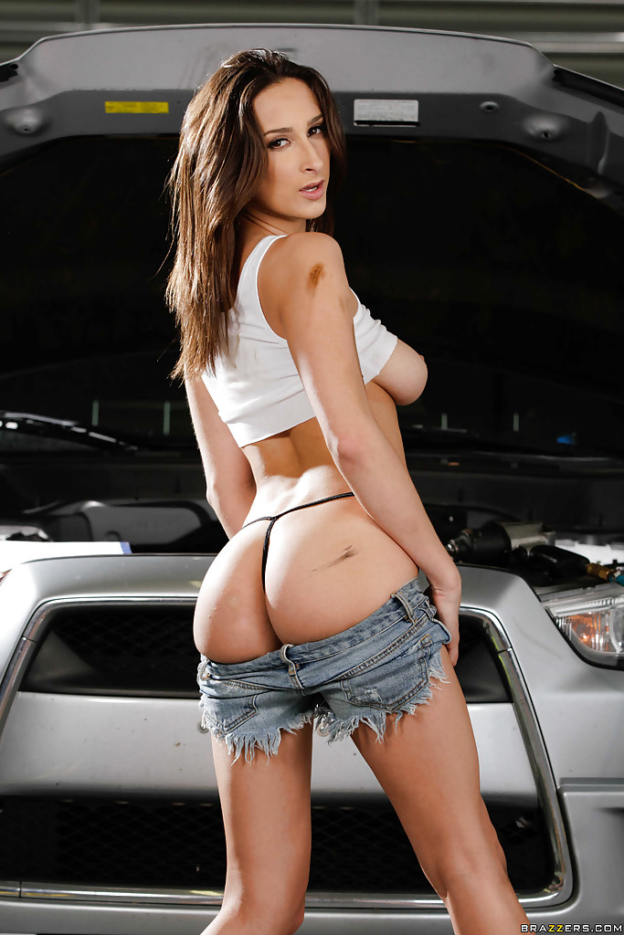 Pornstar ashley adams revealing big natural tits and tight ass in garage