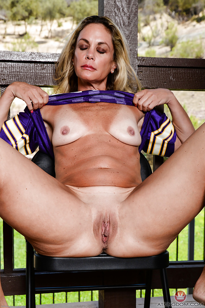 Mature shaved on balcony