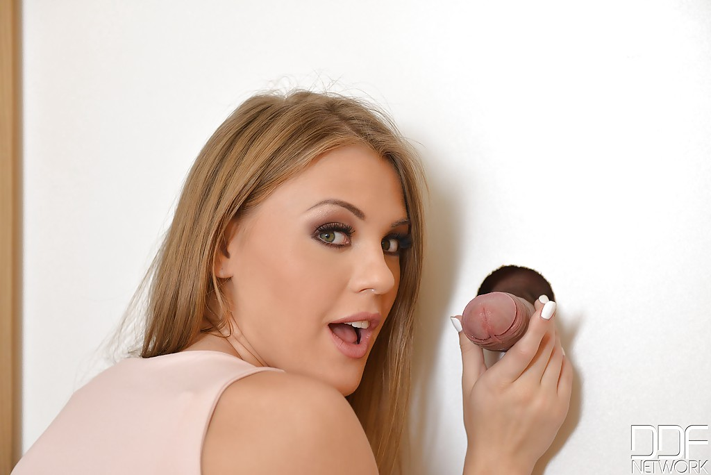 Busty beauty Viola Baileys licking a cock thru the glory hole in door