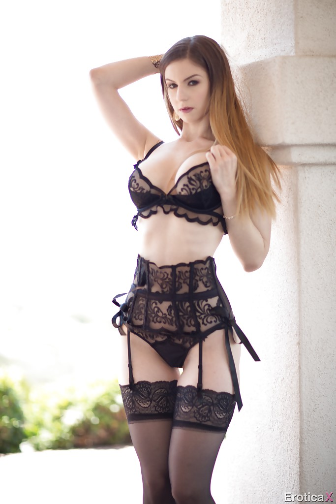 Stunning solo girl stella cox standing in stockings only against stone pillar