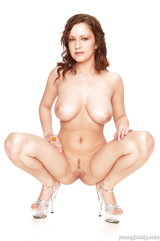 Teen solo girl Lucie proudly shows off big natural tits in high heeled shoes