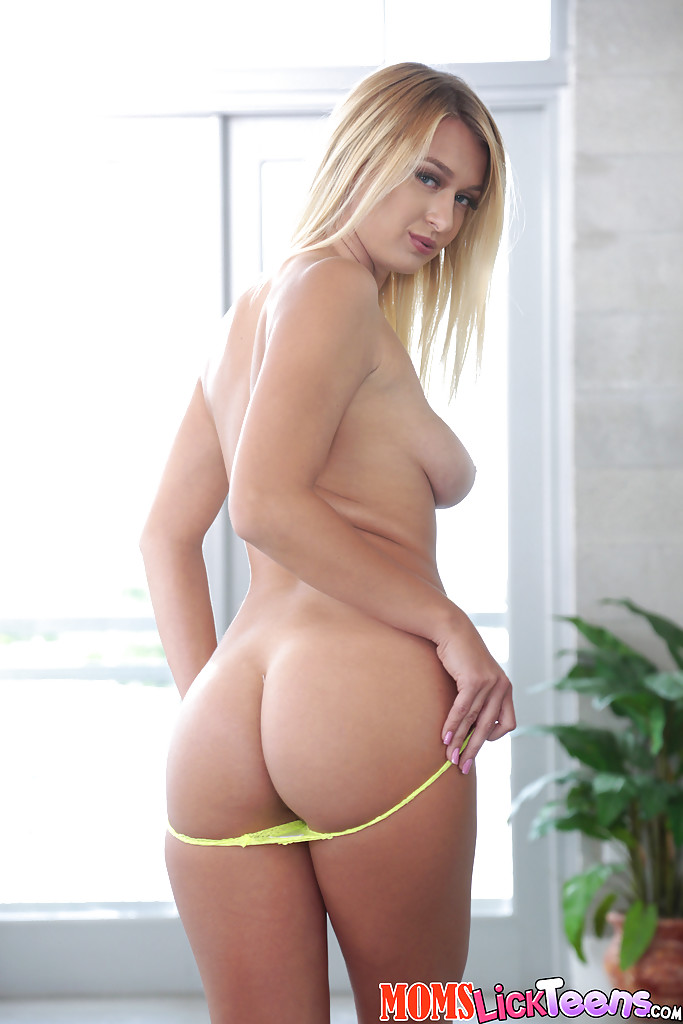 Hot blonde Natalia Starr uncovering nice boobs and phat ass in hallway