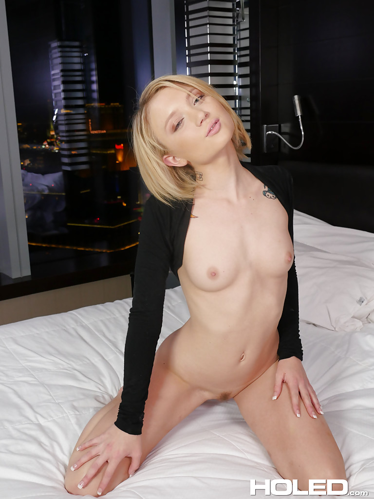 ... Thin blonde girl with short hair Dakota Skye inserting butt plug into  anus ...
