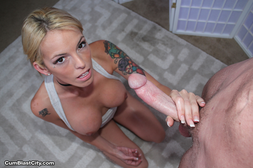 Tattooed blonde female Bella Inc jacking off huge dick for jizz on her face