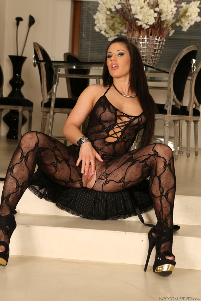 Brunette pornstar Athina in weird black pantyhose demonstrates her candy booty