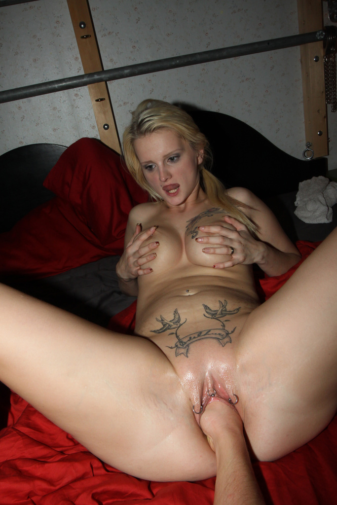 Sexy blonde shows pussy