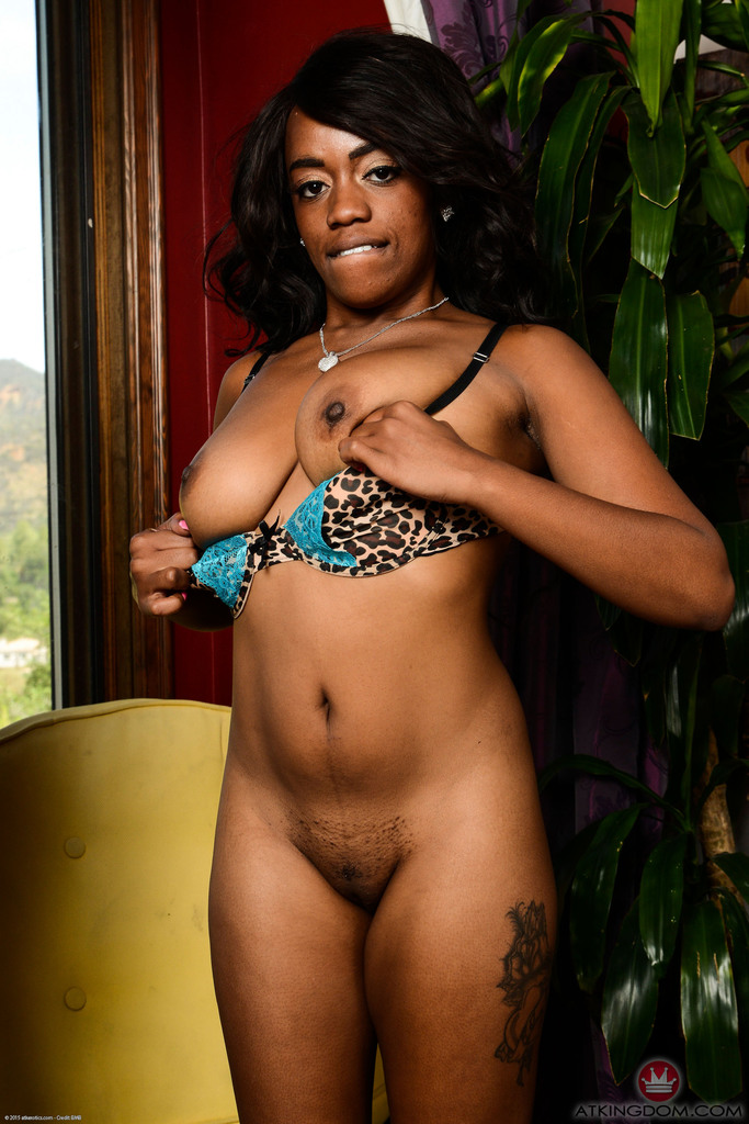 Black first timer Amber Cream parts her labia lips while posing in the nude
