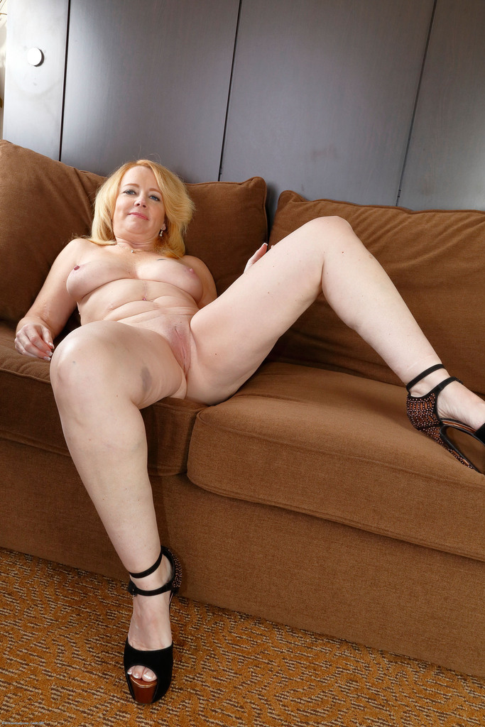 Mature nude posing on couch sorry