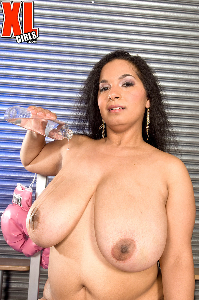 BBW Camelia Davis unleashes her floppy hooters before showing her pussy