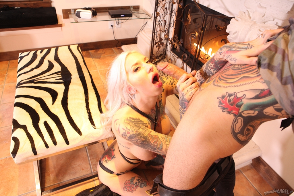 Tattooed chick Rachel Rampage gets banged in front of a fireplace