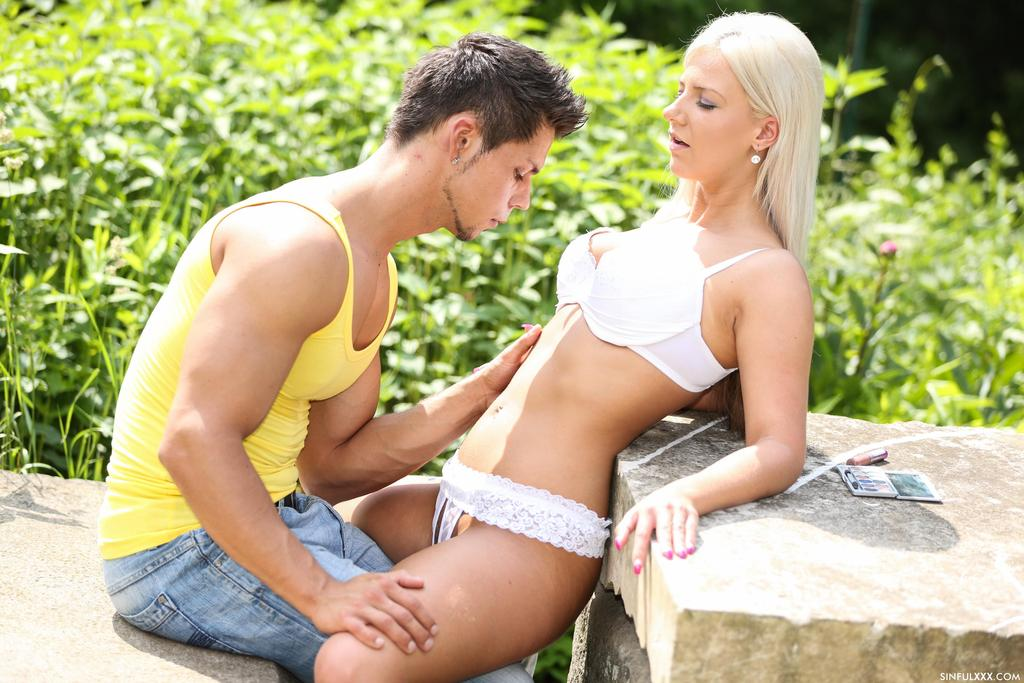 Platinum blonde girl in white pretties gets it on with her lover in garden