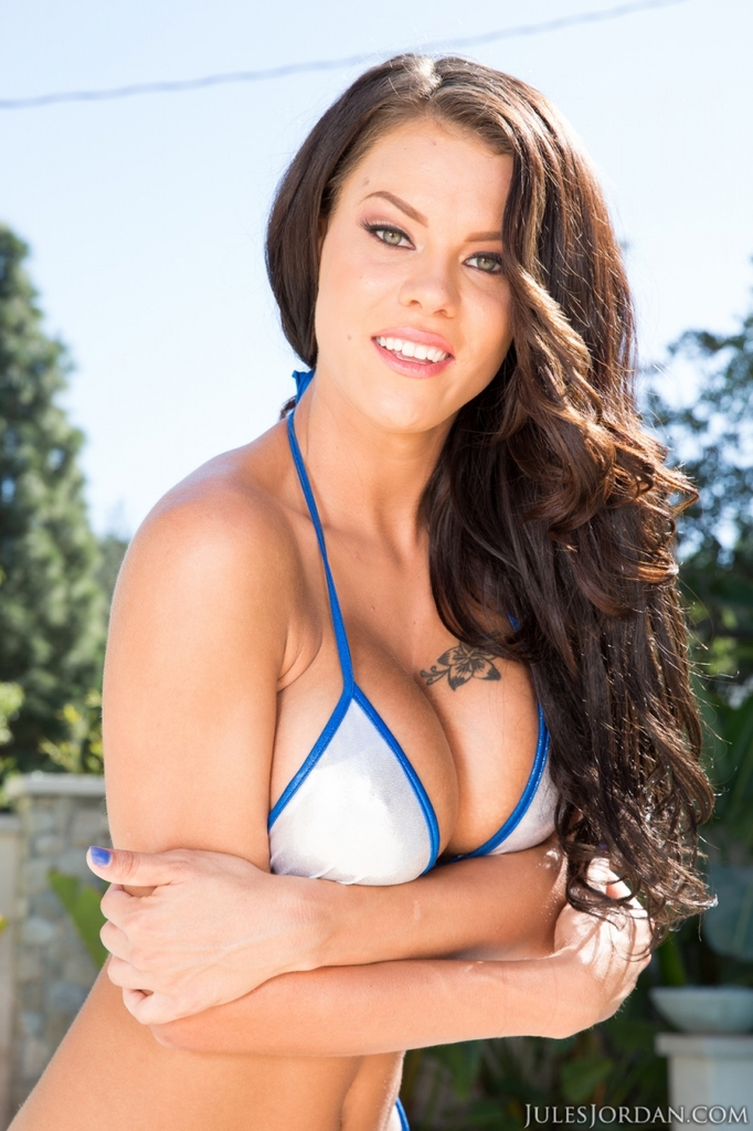 Leggy chick Peta Jensen removes her bikini next to an outdoor pool