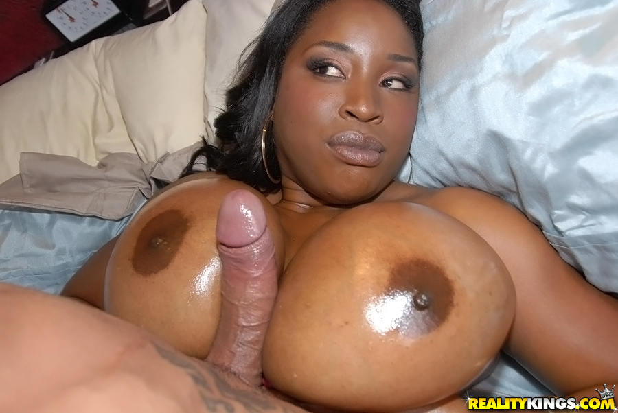 Ebony chick Melissa Reed tit fucks a guy with her oiled up knockers