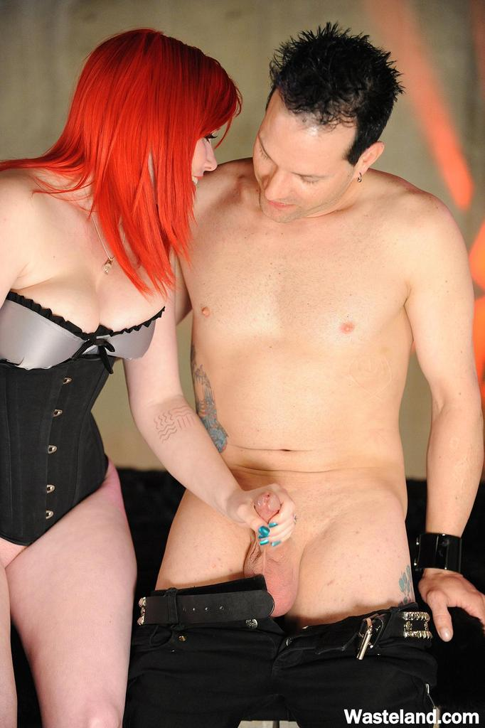 Redhead Domme puts her male and female sex slaves thru their paces