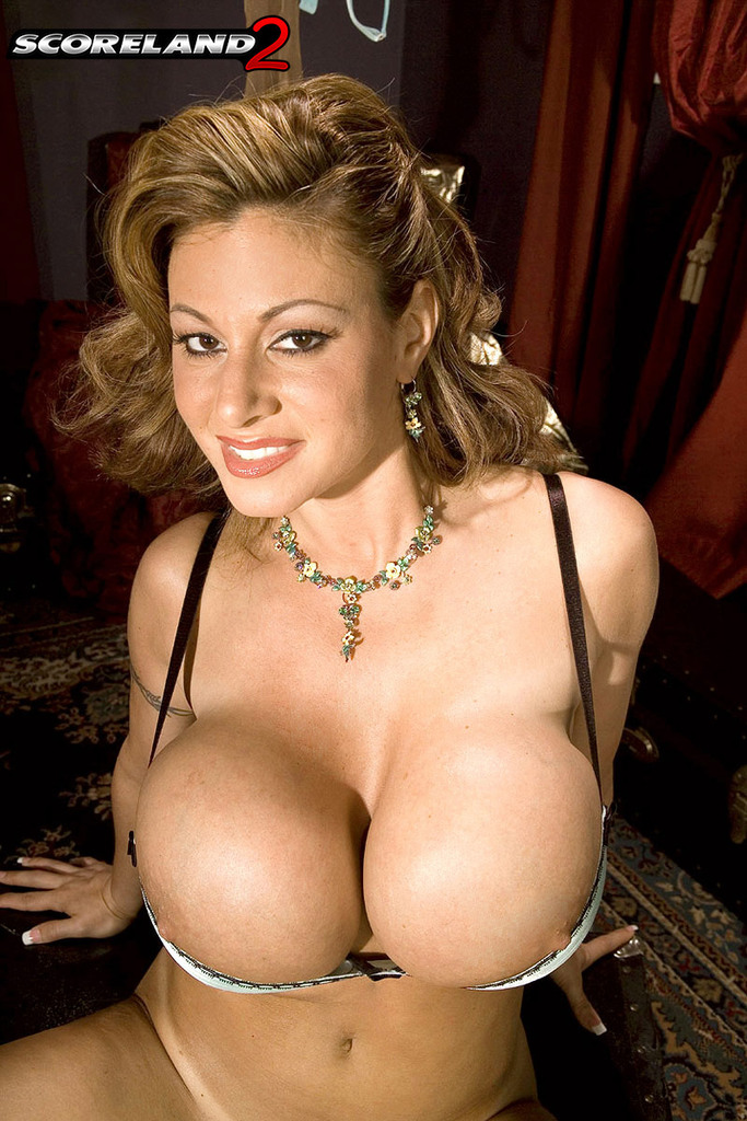 Solo model Crystal Gunns flaunts her huge boobs and bald ...
