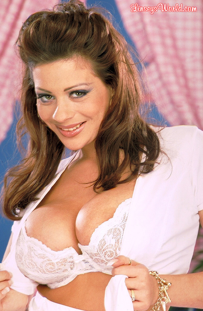 Hot MILF Linsey Dawn McKenzie uncovers her massive tits as she gets naked