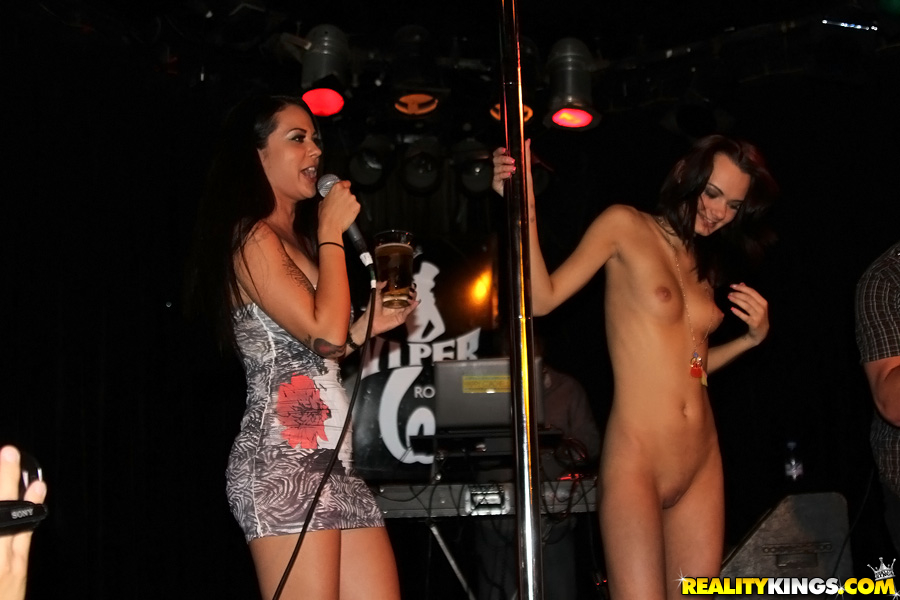 Brunette amateur gets up on stage and takes her clothes off for money